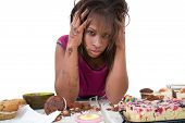 stock photo of bing  - Pretty black woman looking desperate after having had an eating binge - JPG