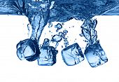 image of ice-cubes  - ice cubes dropped into water with splash isolated - JPG