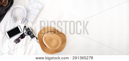 poster of Summer Travel Items On Blanket On Bed.top View Of Accessories Travel (camera,hat,headphone,map ) On