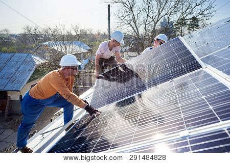 Male Workers Installing Solar Photovoltaic