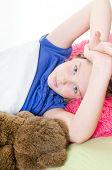 Girl sleeping with lovey bear