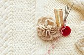 Set For Home Knitting With Crochet  Flower On Pattern Background