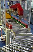 Carton On Roller Conveyor Packing In Automatic Carton Packing Machine poster