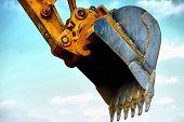 HDR. Shovel bucket against  sky. Urban construction. Kiev,Ukraine