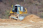 A Yellow Bulldozer Working