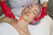 Ultrasound Chromotherapy. Hardware Cosmetology. Beautician Carries Out Procedure For Tightening Skin poster