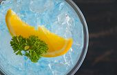 Blue Italian Soda Cold Beverage And Lemon Fruit And Parsley. Blue Italian Soda Cold Beverage With Le poster