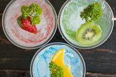 Green Blue Red Italian Soda Cold Beverage And Kiwi Lemon Strawberry Fruit And Parsley. Green Blue Re poster