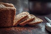 Closeup Of Fresh Homemade Organic Whole Grain Bread With Crispy Crust And Warm Steam Cut Into Slices poster
