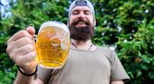 Distinct Beer Culture. Hipster Brutal Bearded Man Hold Mug Cold Fresh Beer. Man Relaxing Enjoying Be poster