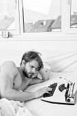 Morning Inspiration Concept. Man Writer Lay Bed White Bedclothes Working On New Book. Writer Author  poster