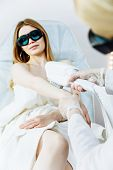 Close Up Laser Hair Removal In The Beauty Salon. Woman Having Hands Epilation. Selective Focus poster