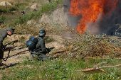stock photo of flamethrower  - German soldier with flame - JPG