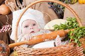 Cute Kid As A Chef Sitting In A Basket