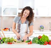 Young Woman Cooking. Healthy Food - Vegetable Salad. Diet. Dieting Concept. Healthy Lifestyle. Cooki