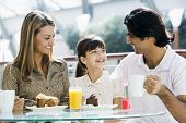 picture of tweeny  - Family at restaurant eating dessert and smiling  - JPG