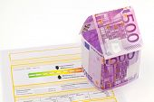 a house made of euro money appear and an energy certificate. building society, building houses and b