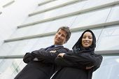 Middle Easterm Business Woman And Wetsern Business Man Stood Outside Offices