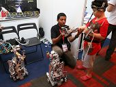 SUBANG JAYA - NOV 10: An unidentified visitor tries out controlling a robot at the World Robot Olymp