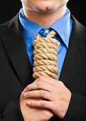 stock photo of strangling  - Businessman with a rope in place of a collar - JPG
