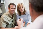 pic of middle-age  - Couple in consultation at IVF clinic  - JPG