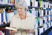 pic of senior-citizen  - Woman in library reading book  - JPG