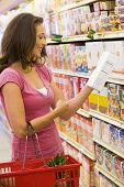 stock photo of food label  - Woman shopping at a grocery store - JPG