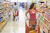 foto of grocery store  - Two women shopping at a grocery store - JPG