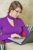 Portrait Of A Businesswoman Working On Laptop