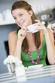 Woman Drinking Tea In Tea Room