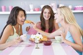 Girlfriends Enjoying Tea And Croissants