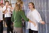 stock photo of misbehaving  - Female teacher reprimanding a female student - JPG