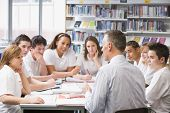 stock photo of medium-  length hair  - Students and teacher in a study group collaborating - JPG
