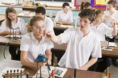 Teen Pupils In Chemistry Lesson