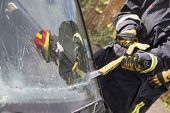 picture of crew cut  - Firefighter cutting out a windshield after an accident - JPG
