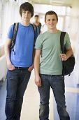 Two Students Standing In Corridor (Selective Focus)