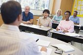 stock photo of students classroom  - Adult students in class with teacher  - JPG