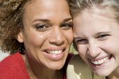 image of close-up middle-aged woman  - Two young women posing outdoors - JPG
