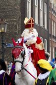 Saint Nicolaas On His White Horse Riding Through The Streets Of Dordrecht