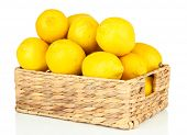 Ripe lemons in wicker basket isolated on white