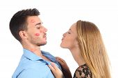 stock photo of fondling  - Woman trying to kiss a man desperately isolated on a white background - JPG