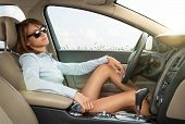 Young Girl Relaxing In The Car