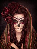 picture of day dead skull  - A young female made up as part of day of the dead celebration - JPG