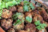 Parsley balls with white paper and salad