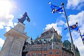 Chateau Frontenac in the day with cloud and blue sky in Quebec City with statue