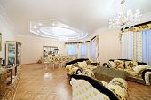 Living and dining room with luxury furniture in classic style.