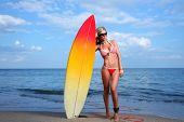 Blonde Girl with a Surf