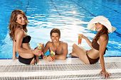 Three Beautiful People At The Pool
