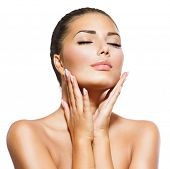 Beauty Portrait. Beautiful Spa Woman Touching her Face. Perfect Fresh Skin. Pure Beauty Model. Youth