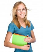 image of skinny girl  - Young skinny student girl is holding exercise books - JPG